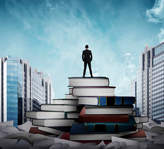 A man standing on a pile of books and documents